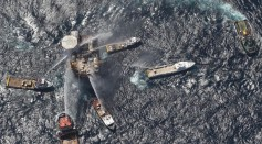 Boats spray water on an oil platform after it exploded in the Gulf of Mexico on September 2, 2010 off the coast of Louisiana.