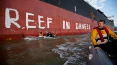 Activists paint the message 'Reef in Danger' on the side of coal ship Chou San on March 7, 2012 in Gladstone, Australia.