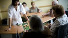 An elderly woman holds a picture of a sheep as she try to remenber the name of the animal during a memory activity at the Cuidem La Memoria elderly home, which specializes in Alzheimer patients on August 2, 2012 in Barcelona, Spain.