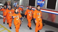 Mission STS-112 crew pilot Pamela Melroy (L), Mission Specialists David Wolf (2nd-L), Fyodor Yurchikhin (RSA) (3rd-L), Commander Jeffrey Ashby (R), Mission Specialists Sandra Magnus and Piers Sellers.