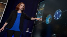 Astronomer Nikole Lewis of the Space Telescope Science Institute in Baltimore presents research findings during a TRAPPIST-1 planets briefing.