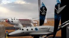 A model of SpaceShipTwo is seen with the original SpaceShipOne visible outside as Virgin Galactic