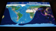 A color plasma screen of world alternates displays of real-time seismic activity at the new earthquake monitoring station June 23, 2004 at the Museum of Natural History in New York City