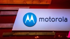 A logo sits illuminated outside the Motorola pavilion during the second day of the Mobile World Congress in Barcelona, Spain.