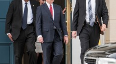 Attorney General Jeff Sessions, center, exits the National Advocacy Center on June 7, 2017 in Columbia, South Carolina.