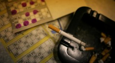 A cigarette rests in an ashtray on top of bingo cards at Carlton Bingo Hall in Orrell Park, Liverpool on April 24, 2007 in Liverpool, England