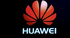 A Huawei logo is shown on a screen during a keynote address by CEO of Huawei Consumer Business Group Richard Yu at CES 2017 at The Venetian Las Vegas on January 5, 2017 in Las Vegas, Nevada