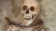 Female 'Vampire' Female in her 30's was buried with a sickle placed across the neck.