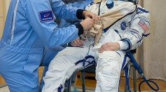 Soyuz MS-11 Anne McClain suits up in a Sokol space suit