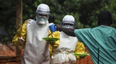 Medical staff working with Medecins sans Frontieres (MSF) prepare to bring food to patients kept in an isolation area at the MSF Ebola treatment centre in Kailahun July 20, 2014.
