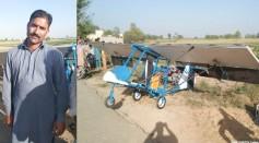 Man beside his homemade airplane