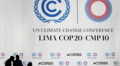 Delegates talk during a break at a plenary session of the U.N. Climate Change Conference COP 20 in Lima December 12, 2014.