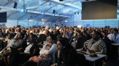 Delegates listen as COP 20 President and Peru's Environment Minister Manuel Pulgar Vidal makes an announcement during a plenary session of the U.N. Climate Change Conference COP 20 in Lima December 12, 2014.
