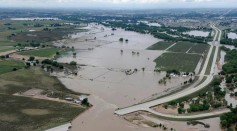 How Community Fares in an Extreme Storm Shape Climate Beliefs