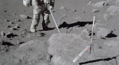 Scientist-astronaut Harrison Schmitt, Apollo 17 lunar module pilot, uses an adjustable sampling scoop