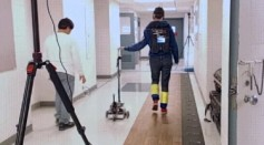 Robotic cane tested by a patient