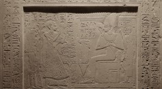 Egyptian gods standing before Osiris.