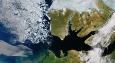 One can see the sea ice in the Canadian Archipelago's waterways, as well as well as the cracked sea ice found in the Beaufort Sea