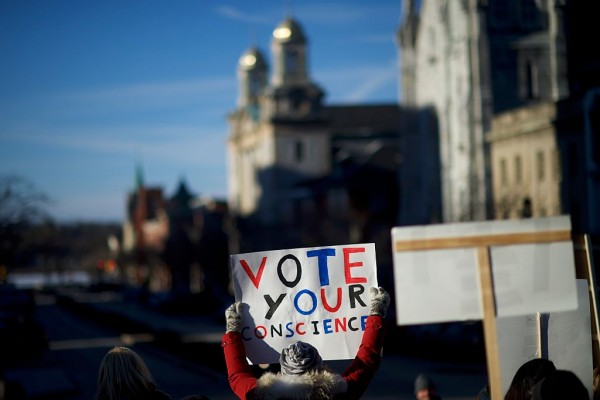 Electoral College Voters Cast Ballots Amid Protests
