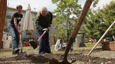 Volunteers Clean Up Community Garden On Earth Day