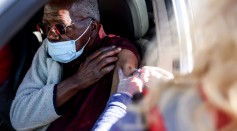 Science Times - Covid-19 Vaccine Drive Inoculates Thousands Of Elderly In Denver