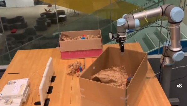 RF Grasp: The robot that finds its way through clutter