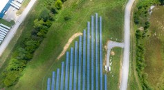 aerial-view-of-solar-panels-array-on-green-grass-2800845