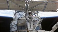 NASA Astronaut Works On Hubble Space Telescope