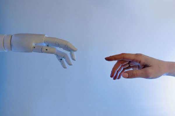person-reaching-out-to-a-robot-8386434