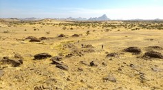 Landscape views of scatters of qubbas around the Jebel Maman.