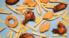 fried-potatoes-with-onion-rings-and-chicken-wings-and-nuggets-6941027