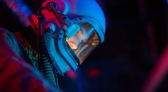 woman-in-a-spacesuit-with-blue-helmet-7672255