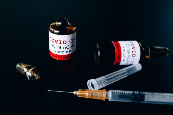 covid-vaccine-bottles-and-syringe-5863437