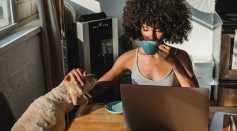 african-american-female-freelancer-using-laptop-and-drinking-coffee-5256142