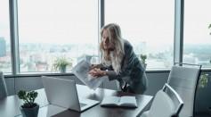 woman-in-gray-blazer-talking-in-front-of-a-laptop-5717555/