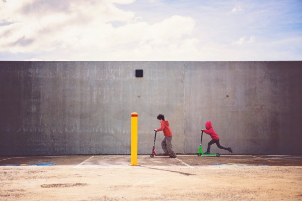two-boys-playing-kick-scooter-551581
