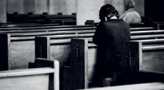 unrecognizable-men-praying-in-old-catholic-church-4235012/