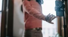 woman-in-warm-knitwear-clothes-taking-selfie-on-smartphone-7585806/