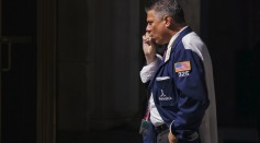 A trader smokes outside the New York Stock Exchange