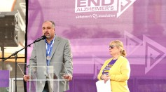 Bankers Life Regional Director Farshad Asl and Alzheimers Association California Southland Chapter Executive Director Breena Gold speak onstage during the Walk to End Alzheimer's Los Angeles.