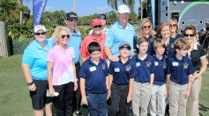 Ernie Els of South Africa poses with a group of children during the Els #GameON Autism clinic as a preview for The Honda Classic on the Champions Course at the PGA National Resort and Spa.