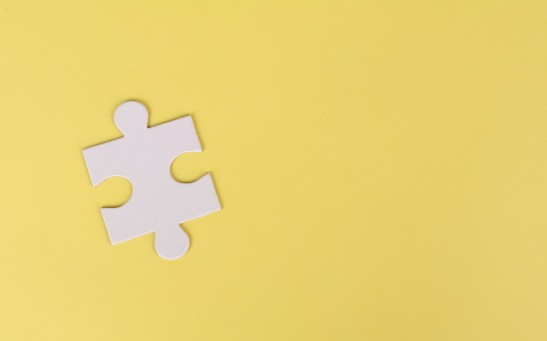 jigsaw-puzzle-on-yellow-background-3482443